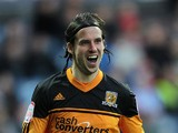 Hull's George Boyd celebrates after scoring the opening goal against Huddersfield on March 30, 2013