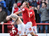 Forest's Henri Lansbury is congratulated by team mate Simon Cox after grabbing a late equaliser against Brighton on March 30, 2013