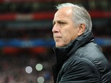 Montpellier manager Rene Girard watches his side's Champions League match against Arsenal on November 21, 2012