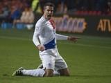 Holland forward Robin Van Persie celebrates a goal against Romania on March 26, 2013