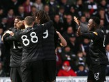 Celtic players celebrate Kris Commons goal in the SPL clash at St Mirren on March 31, 2013