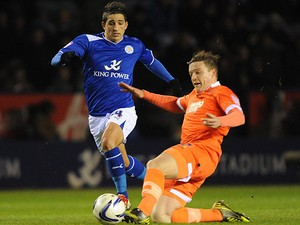 Leicester's Anthony Knockaert and Millwall's Shane Lowry battle for the ball on March 29, 2013
