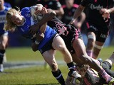 A Stade Francais player tackles Bath's Tom Biggs during the Challenge Cup match on April 6, 2013