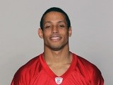 New Dolphins signing Brent Grimes in his Falcons photocall on July 19, 2012