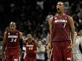 Miami Heat's Chris Bosh celebrates after scoring the winning basket against San Antonio Spurs on March 31, 2013