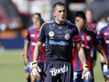 San Lorenzo's goalkeeper Pablo Migliore walks on to the pitch with teammates on March 16, 2013