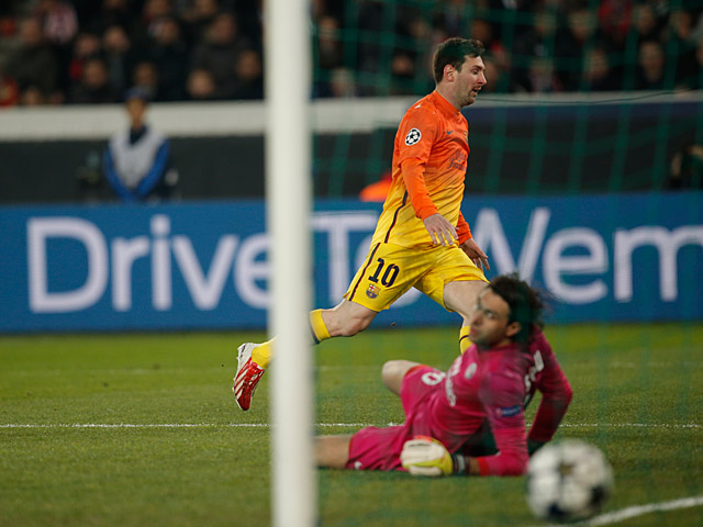 Barcelona's Lionel Messi scores the opening goal against Paris Saint-Germain on April 2, 2013