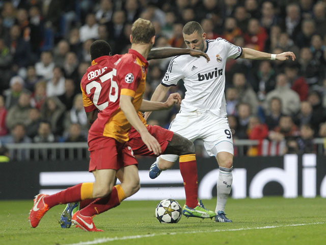 Real Madrid's Karim Benzema scores his side's second goal in their Champions League match against Galatasaray on April 3, 2013