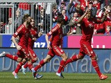 Bayern Munich's Jerome Boateng celebrates scoring against FC Nuremberg on April 13, 2013