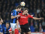 Cardiff City's Ben Turner and Barnsley's Richard Foster battle for the ball during the Championship match on April 9, 2013