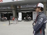 Sauber's Esteban Gutierrez stands in front of the pit lane on at the Chinese GP on April 14, 2013