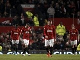 United players walk off dejected following defeat to Man City on April 8, 2013