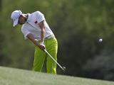 Amateur Tianlang Guan plays a shot on April 8, 2013