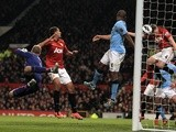 City skipper Vincent Kompany scores an own goal during the Manchester Derby on April 8, 2013