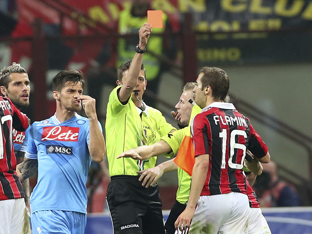 AC Milan midfielder Mathieu Flamini is shown a red card during the Serie A match with Napoli on April 14, 2013