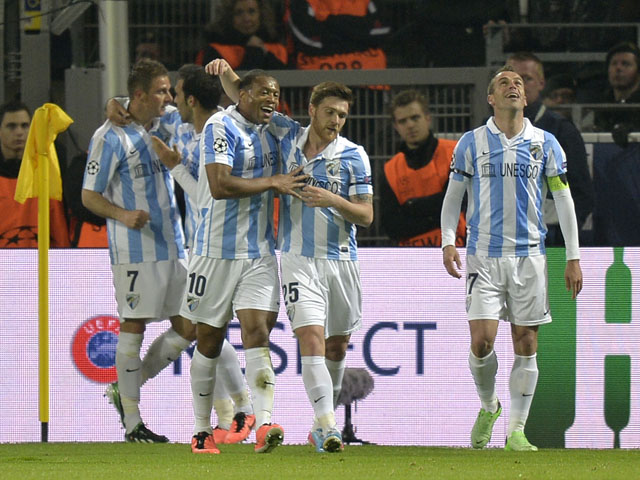 Malaga players celebrate after Joaquin's goal in the Champions League match against Borussia Dortmund on April 9, 2013