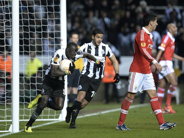 Newcastle's Papiss Cisse grabs the ball after scoring against Benfica on April 11, 2013