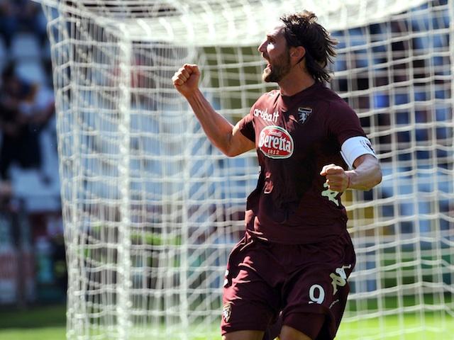 Torino's Rolando Bianchi celebrates a goal against Roma on April 14, 2013