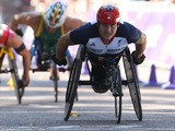 Great Britain's David Weir crosses the line to win gold in the Men's Marathon T54 on September 9, 2012