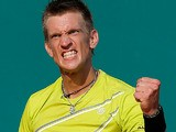 Jarkko Nieminen celebrates after defeating Juan Martin Del Potro in the Monte Carlo Masters on April 18, 2013