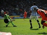 Jermaine Beckford scores for Huddersfield against Millwall on April 20, 2013