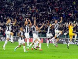 Juventus' players celebrate their win over AC Milan in the Serie A clash on April 21, 2013