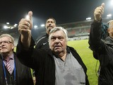 Montpellier's President Louis Nicollin gives the thumbs up to fans as they celebrate winning their first Ligue 1 title on May 20, 2012