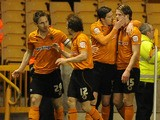 Wolverhampton Wanderers' Kevin Doyle celebrates scoring against Hull City in the Championship match on April 16, 2013