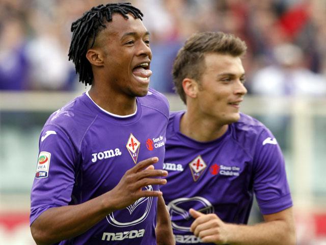 Fiorentina's Juan Cuadrado celebrates scoring against Torino in the Serie A clash on April 21, 2013