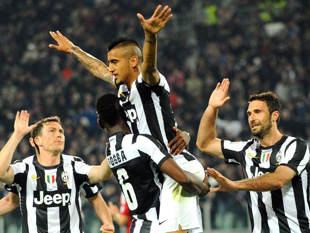 Juventus midfielder Arturo Vidal celebrates scoring against AC Milan on April 21, 2013