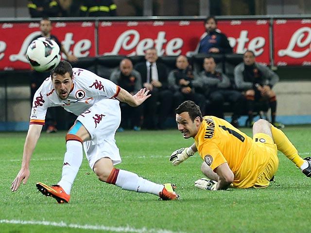 Roma's Mattia Destro scores the equaliser against Inter on April 17, 2013