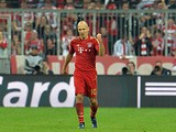 Bayern's Arjen Robben celebrates scoring his side's third goal against Barcelona on April 23, 2013