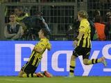 Borussia Dortmund's Robert Lewandowski celebrates scoring his third goal against Real Madrid on April 24, 2013