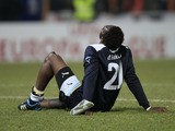 Lazio's Modibo Diakite sit on the pitch during the Europa League match against FC Vaslui on December 1, 2011