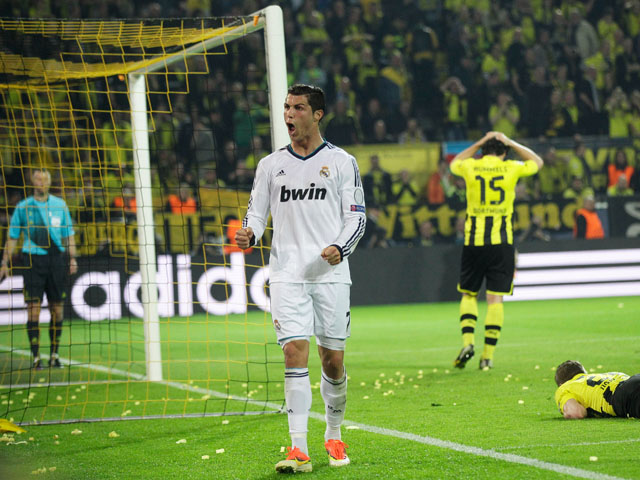 Real Madrid's Cristiano Ronaldo celebrates after scoring in the Champions League semi final match against Borussia Dortmund on April 24, 2013