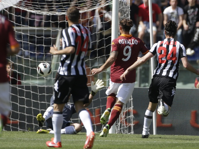 Roma's Pablo Osvaldo scores against Siena on April 28, 2013