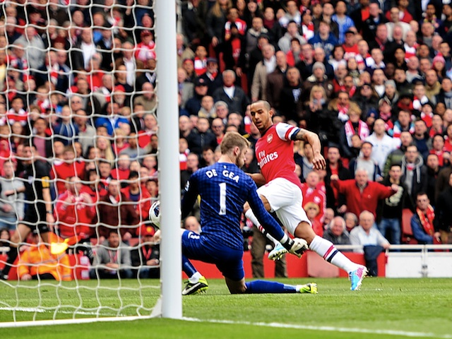 Arsenal's Theo Walcott gives his team an early lead against Man Utd on April 28, 2013