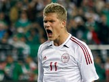 Denmark's Andreas Cornelius celebrates after scoring a penalty during a friendly match against Mexico on January 30, 2013