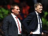 Rival bosses David Moyes and Brendan Rodgers standing on the touchline on May 5, 2013