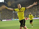 Dortmund's Kevin Grosskreutz celebrates after scoring against Bayern Munich on May 4, 2013