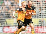 Hull City's Paul McShane celebrates scoring against Cardiff City on May 4, 2013