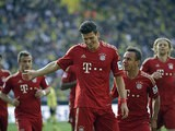 Bayern's Mario Gomez is congratulated by team mates after scoring the equaliser against Dortmund on May 4, 2013