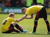 Watford's Matej Vydra gets helped up by Mark Yeats after they lost to Leeds United during the final day of the Championship Season on May 4, 2013