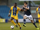 Crystal Palace's Yannick Bolasie and Millwall's Sean St Ledger battle for the ball on April 30, 2013