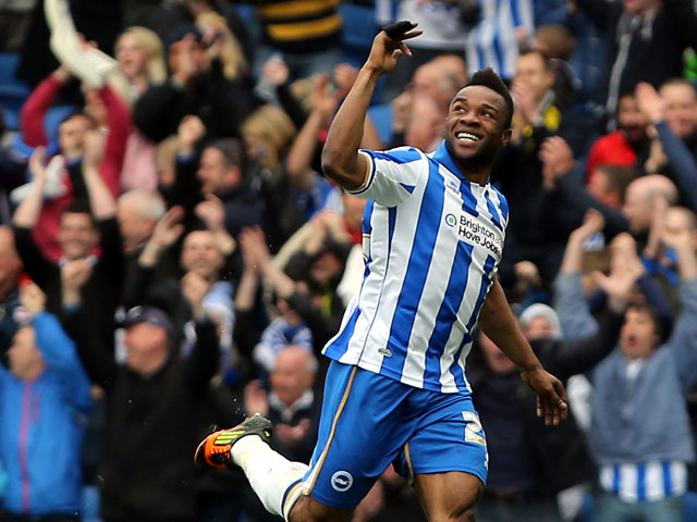 Brighton's Kazenga LuaLua celebrates scoring against Wolverhampton Wanderers during the final day of the Championship season on May 4, 2013