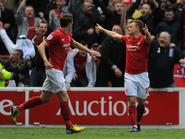 Nottingham Forest's Simon Cox celebrates scoring against Leicester City on May 4, 2013