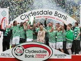 Celtic players celebrate with the SPL trophy on May 11, 2013