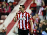 John O'Shea celebrates after scoring the equaliser against Stoke on May 6, 2013