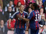 Jon Walters celebrates with team mate Cameron Jerome after scoring the opener against Sunderland on May 6, 2013