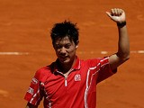 Kei Nishikori celebrates his win over Jurgen Melze in the Madrid Open on May 6, 2013